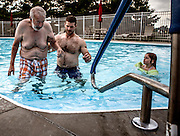 Morgan helps his dad wade through the pool while his daughter Reese floats along watching. This was the first time the family had taken Tom swimming, and his face broke out into a huge smile as he enjoyed the water. Reese, who doesn't really understand what her parents mean when they say Grandpa Tom's brain is broken is always curious and always watching.