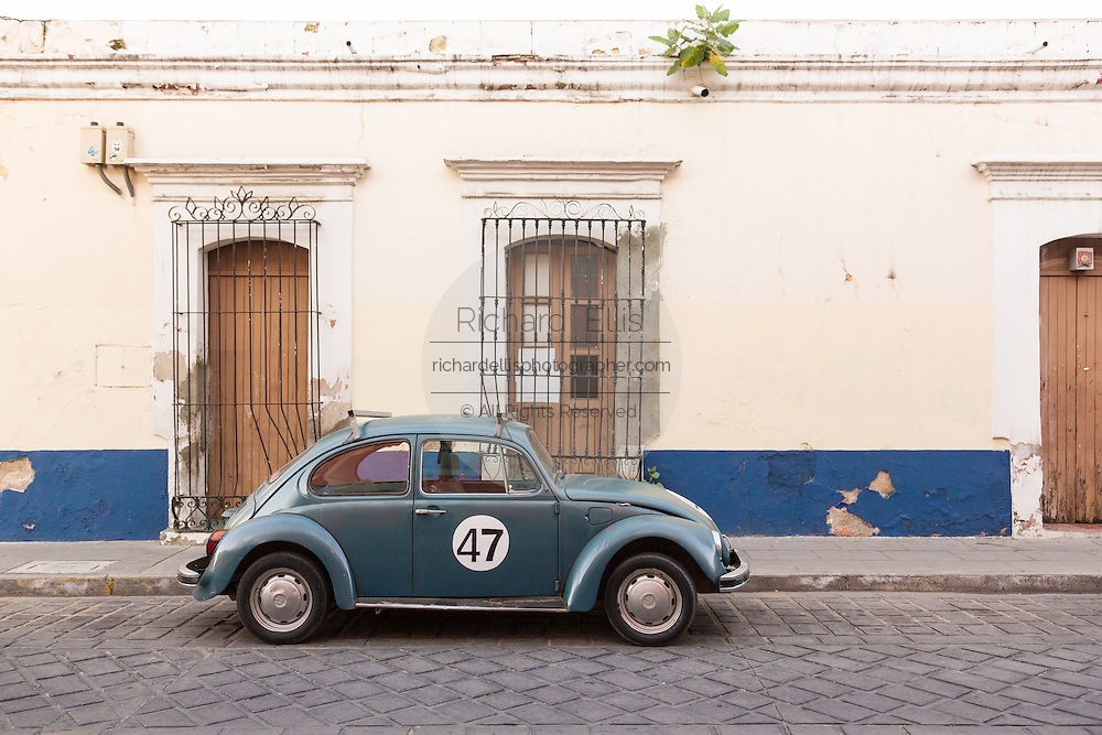 An old Volkswagen beetle parked on a cobble street  October 27, 2013 in Oaxaca, Mexico. Beetles were produced in Mexico until 2004.