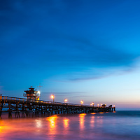 San Clemente pier at night during sunset photo. San Clemente is a popular coastal town in Orange County in Southern California in the United States of America. Copyright ⓒ 2017 Paul Velgos with all rights reserved.