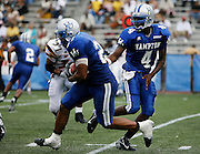 Hampton's TJ Mitchell (4) hands off to Van Morgan (27) during their game against Grambling in the 2006 MEAC-SWAC Football Challenge at Legion Field in Birmingham, Alabama.  Hampton won 27-26 in OT.  September 02, 2006  (Photo by Mark W. Sutton)