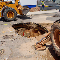 City of Grants employees work to repair a sinkhole on Naomi Road in Grants Tuesday.