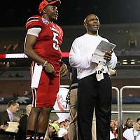 Louisville Cardinals quarterback Teddy Bridgewater (5)  and Head Coach Charlie Strong wait on the podium after the NCAA Football Russell Athletic Bowl football game between the Louisville Cardinals and the Miami Hurricanes, at the Florida Citrus Bowl on Saturday, December 28, 2013 in Orlando, Florida. Louisville won the game by a score of 36-9. (AP Photo/Alex Menendez)