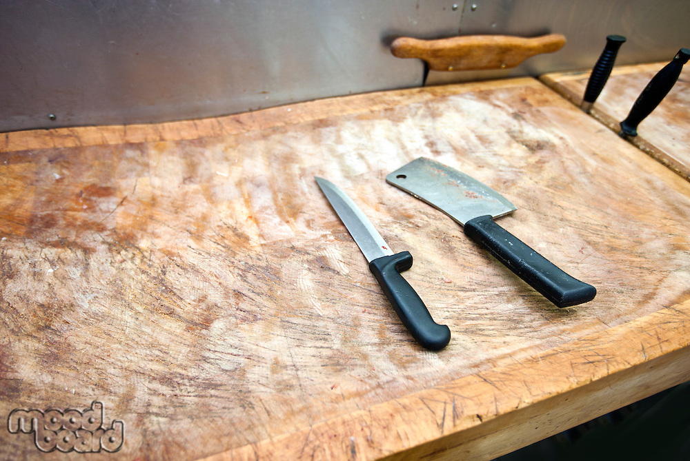 Butcher knife on cutting board in supermarket