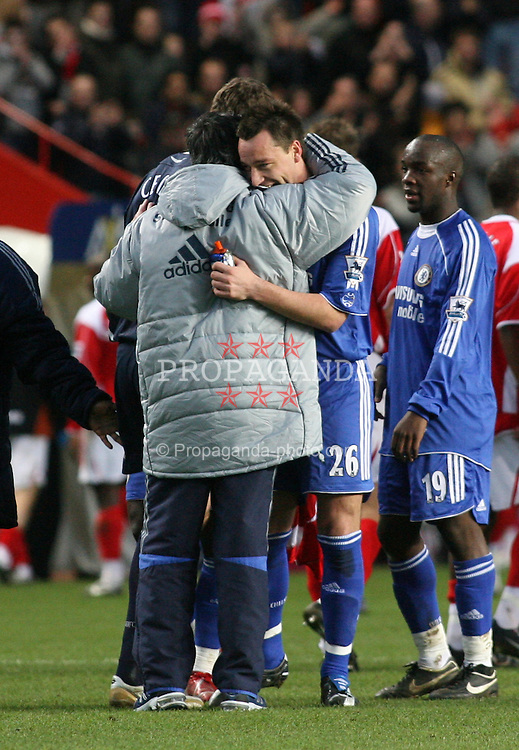 London, England - Tuesday, January 23, 2007: Chelsea's John Terry is hugged by manager Jose Mourinho at the end against Charlton Athletic during the Premiership match at the Valley. (Pic by Chris Ratcliffe/Propaganda)