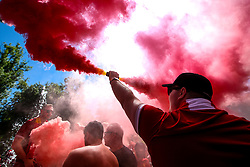 A Liverpool fan lets off a flare in the fan park in Kiev ahead of the Champions League Final against Real Madrid - Mandatory by-line: Robbie Stephenson/JMP - 26/05/2018 - FOOTBALL - Olympic Stadium - Kiev,  - Real Madrid v Liverpool - UEFA Champions League Final