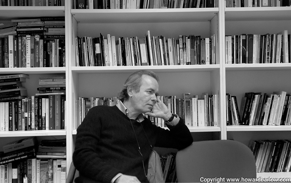 .Photographer: Howard Barlow.MARTIN AMIS writer - in conversation in his office at Manchester University