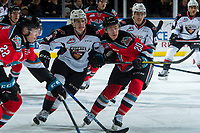 KELOWNA, CANADA - NOVEMBER 10: Brayden Watts #34 of the Vancouver Giants checks Conner Bruggen-Cate #20 of the Kelowna Rockets on November 10, 2017 at Prospera Place in Kelowna, British Columbia, Canada.  (Photo by Marissa Baecker/Shoot the Breeze)  *** Local Caption ***