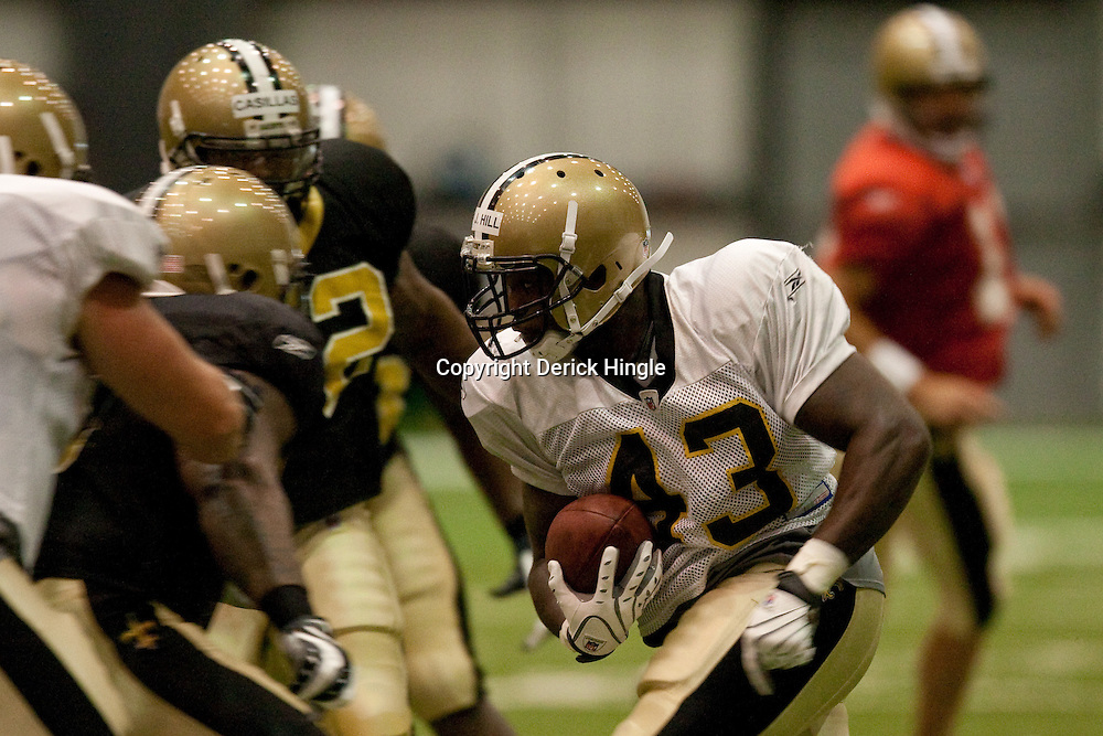 08 August 2009: Rookie running back P.J. Hill (43) runs through traffic during the New Orleans Saints annual training camp Black and Gold scrimmage held at the team's indoor practice facility in Metairie, Louisiana.