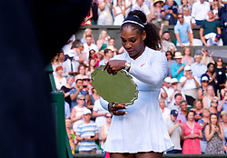LONDON, ENGLAND - Saturday, July 14, 2018: Serena Williams (USA) looks at her runner-up silver plate after losing the the Ladies' Singles Final match 6-3, 6-3 on day twelve of the Wimbledon Lawn Tennis Championships at the All England Lawn Tennis and Croquet Club. (Pic by Kirsten Holst/Propaganda)