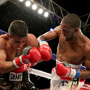 John Correa punches Alejandro Barbosa during a Telemundo boxing match at Osceola Heritage Park on Friday, July 20, 2018 in Kissimmee, Florida.  (Alex Menendez via AP)