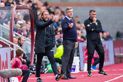 Heart of Midlothian assistant manager Austin MacPhee and Heart of Midlothian manager Craig Levein signal to their players during the Ladbrokes Scottish Premiership match between Heart of Midlothian and Rangers FC at Tynecastle Park, Edinburgh, Scotland on 20 October 2019.