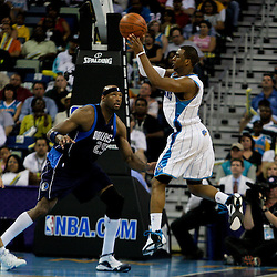 12 April 2009: New Orleans Hornets guard Chris Paul (3) passes away from Dallas Mavericks center Erick Dampier (25) during a 102-92 victory by the New Orleans Hornets over the Dallas Mavericks on Easter Sunday at the New Orleans Arena in New Orleans, Louisiana.