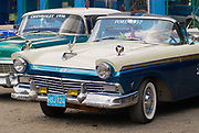 HAVANA, CUBA - OCTOBER 21, 2006: Vintage Ford and Chevrolet cars parked at the street in Havana, Cuba.