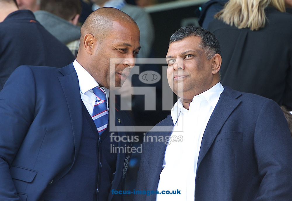 Queens Park Rangers chairman Tony Fernandes (right) and Rio Ferdinand during the Barclays Premier League match at the Loftus Road Stadium, London<br /> Picture by Alan Stanford/Focus Images Ltd +44 7915 056117<br /> 16/05/2015