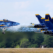 BRUNSWICK Maine- 8/26/17 --  U.S. Navy Blue Angels demonstration team takes of from at Brunswick Executive Airport on Saturday. The Blue Angels flew as part of the Great State of Maine Airshow this weekend. Officials estimated that over 100,000 people enjoyed the show from inside and outside the gates. There were more static displays than there were in 2015's show and officials concluded not was a larger draw than in previous years.  Photo by Roger S. Duncan for The Forecaster.