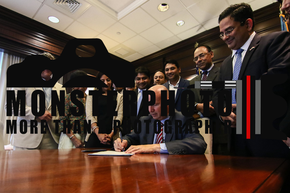 Gov. Markell (Center) signs into law the creation of a Commission on Indian Heritage and Culture while members of Delaware's Indian committee watch Thursday, Sept. 01, 2016, at the Carvel State Office Building in Wilmington.