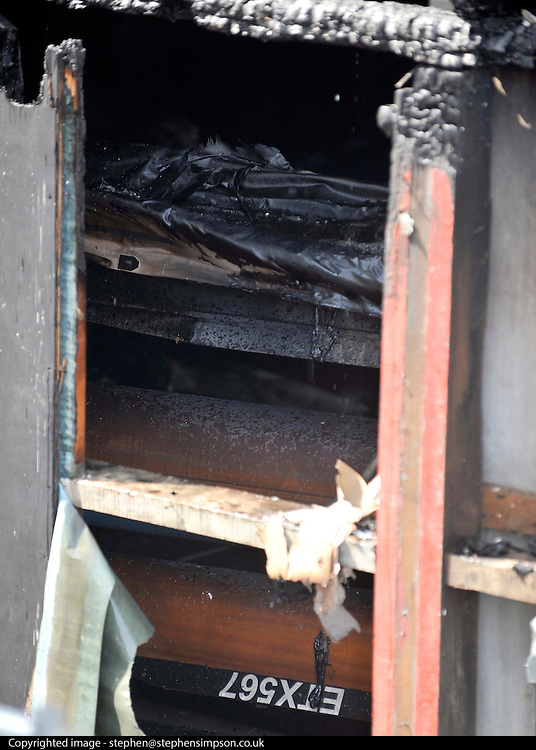 © licensed to London News Pictures. MARLOW, UK.  03/08/11. Damaged boats. Marlow Rowing Club has been badly damaged by fire today (03 August 2011). Boats with an estimated value of 100,000 pounds have been damaged. Steve Redgrave, Olympic Rower, who trained at the club and is from Marlow said his daughters boat is believed to be inside.  Mandatory Credit Stephen Simpson/LNP