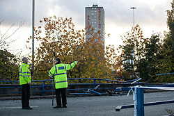 © Licensed to London News Pictures. 27/10/2019. Salford, UK. Police carry out a survey of the scene . A car lies on its side on a pedestrian walkway at the Pendleton Roundabout on Broad Street in Salford . Members of the public pulled a man and a woman from the wreckage after a BMW car crashed through a barrier and landed on a pedestrian walkway below . Their condition is unknown and police , paramedics and fire crews are at the scene . Photo credit: Joel Goodman/LNP