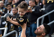 LAFC fan holds a child during a MLS soccer match against the Sporting KC in Los Angeles, Sunday, March 3, 2019. LAFC defeated Sporting KC, 2-1. (Ed Ruvalcaba/Image of Sport)