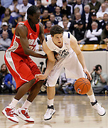 BYU guard Jimmer Fredette, right, is pressured by New Mexico guard Tony Snell during the second half of an NCAA college basketball game in Provo, Utah, Wednesday, March. 2, 2011. New Mexico defeated third-ranked BYU, 82-64. (AP Photo/Colin E Braley).