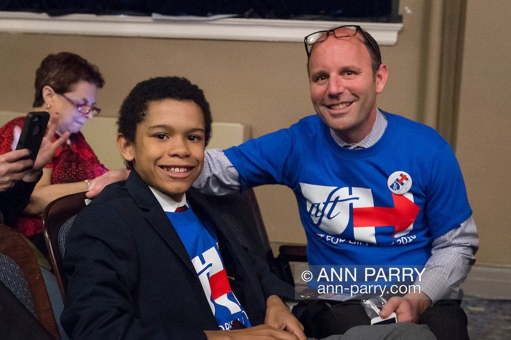 JOSH ZWERIN, 12, and his dad JEFF FRIEDMAN, 47, of Rockville Centre, are wearing Hillary 2016 shirts, as they sit in audience ready for start of HILLARY CLINTON, leading Democratic presidential primary candidate, discussion on gun violence prevention, and activists who lost family members due to shootings. Clinton called for tougher gun control legislation and vowed to take on the gun lobby, NRA National Rifle Association. New York presidential primary is April 19.