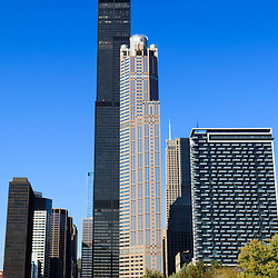 Chicago cityscape with Willis Tower (Sears Tower) skyscraper along the Chicago River. Willis Tower is one the world's tallest buildings and is one of Chicago's most recognizable symbols. Photo is vertical and high resolution.