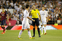 Real Madrid´s Isco and referee Mateu Lahoz during the Spanish Copa del Rey `King´s Cup´ final soccer match between Real Madrid and F.C. Barcelona at Mestalla stadium, in Valencia, Spain. April 16, 2014. (ALTERPHOTOS/Victor Blanco)
