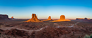 West and East Mitten Buttes and Merrick Butte at sunset in Monument Valley Navajo Tribal Park, Arizona, USA. The Western movie director John Ford set several popular films here. This image was stitched from multiple overlapping photos.