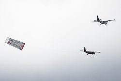 "Trafalgar Square, London, June 22nd 2016. Thousands of people flood London's Trafalgar Square to celebrate what would have been slain Labour MP for Batley & Spen Jo Cox's 42nd birthhday. PICTURED: As thousands remember Jo Cox, the poignant moment is disturbed by two aircraft circling central London with a banner proclaiming ""Take Control, Vote Leave""."
