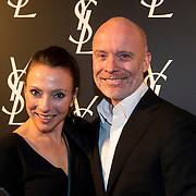 NLD/Amsterdam//20140324 - Filmpremière Yves Saint Laurent, Maybritt Mobach en Mart Visser