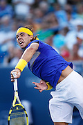 CINCINNATI, OH - AUGUST 20: Rafael Nadal of Spain serves to Paul-Henri Mathieu of France during day four of the Western & Southern Financial Group Masters on August 20, 2009 at the Lindner Family Tennis Center in Cincinnati, Ohio. Nadal defeated Mathieu 7-5, 6-2. (Photo by Joe Robbins)
