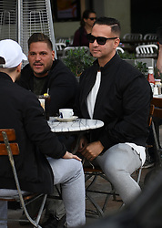 "EXCLUSIVE: Jersey Shore cast-mates Mike ""The Situation"" Sorrentino, Vinny Guadagnino and Ronnie Ortiz-Magro walk down Ocean Drive carrying ""Do You Want to Marry/Date DJ Pauly D"" signs while filming the reboot Jersey Shore: Family Vacation in Miami Beach, Florida. 31 Jan 2018 Pictured: Mike ""The Situation"" Sorrentino, Vinny Guadagnino, Ronnie Ortiz-Magro. Photo credit: MEGA TheMegaAgency.com +1 888 505 6342"