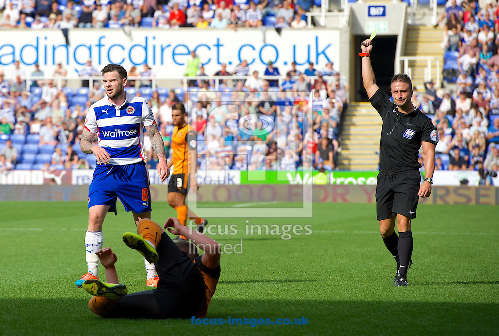 Danny Guthrie of Reading is shown the yellow card by referee James Adcock during the Sky Bet Championship match at the Madejski Stadium, Reading<br /> Picture by Alan Stanford/Focus Images Ltd +44 7915 056117<br /> 28/09/2014
