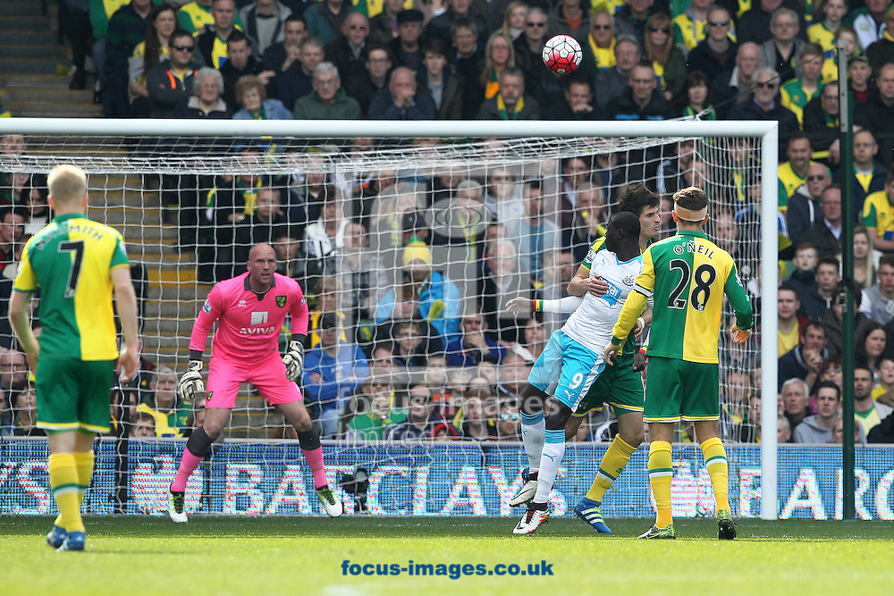 Papiss Cisse of Newcastle United heads for goal during the Barclays Premier League match at Carrow Road, Norwich<br /> Picture by Paul Chesterton/Focus Images Ltd +44 7904 640267<br /> 02/04/2016