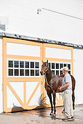 Jon Niehaus, a groom at Claiborne Farm, walks retired 2013 Kentucky Derby winner Orb after the 10 a.m. Stallion Division tour Wednesday, Oct. 7, 2015, at the private working farm north of Lexington near Paris, Ky. (Photo by Brian Bohannon)