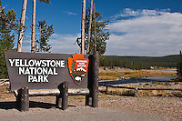 Sign at the south entrance gate to Yellowstone National Park.  Wyoming, USA.