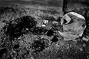 All that remains of a local village leader is a trail of blood and an image of Christ laid upon the remains by locals as a mark of respect. The man was murdered by Pro-autonomy Militia. August 1999