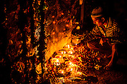 "18th December 2014, New Delhi, India. A man lights an incense stick as an  offering as he asks for wishes to be granted by Djinns in the ruins of Feroz Shah Kotla in New Delhi, India on the 18th December 2014<br /> <br /> PHOTOGRAPH BY AND COPYRIGHT OF SIMON DE TREY-WHITE a photographer in delhi<br /> + 91 98103 99809. Email: simon@simondetreywhite.com<br /> <br /> People have been coming to Firoz Shah Kotla to leave written notes and offerings for Djinns in the hopes of getting wishes granted since the late 1970's. Jinn, jann or djinn are supernatural creatures in Islamic mythology as well as pre-Islamic Arabian mythology. They are mentioned frequently in the Quran  and other Islamic texts and inhabit an unseen world called Djinnestan. In Islamic theology jinn are said to be creatures with free will, made from smokeless fire by Allah as humans were made of clay, among other things. According to the Quran, jinn have free will, and Iblis abused this freedom in front of Allah by refusing to bow to Adam when Allah ordered angels and jinn to do so. For disobeying Allah, Iblis was expelled from Paradise and called ""Shaytan"" (Satan).They are usually invisible to humans, but humans do appear clearly to jinn, as they can possess them. Like humans, jinn will also be judged on the Day of Judgment and will be sent to Paradise or Hell according to their deeds. Feroz Shah Tughlaq (r. 1351–88), the Sultan of Delhi, established the fortified city of Ferozabad in 1354, as the new capital of the Delhi Sultanate, and included in it the site of the present Feroz Shah Kotla. Kotla literally means fortress or citadel."