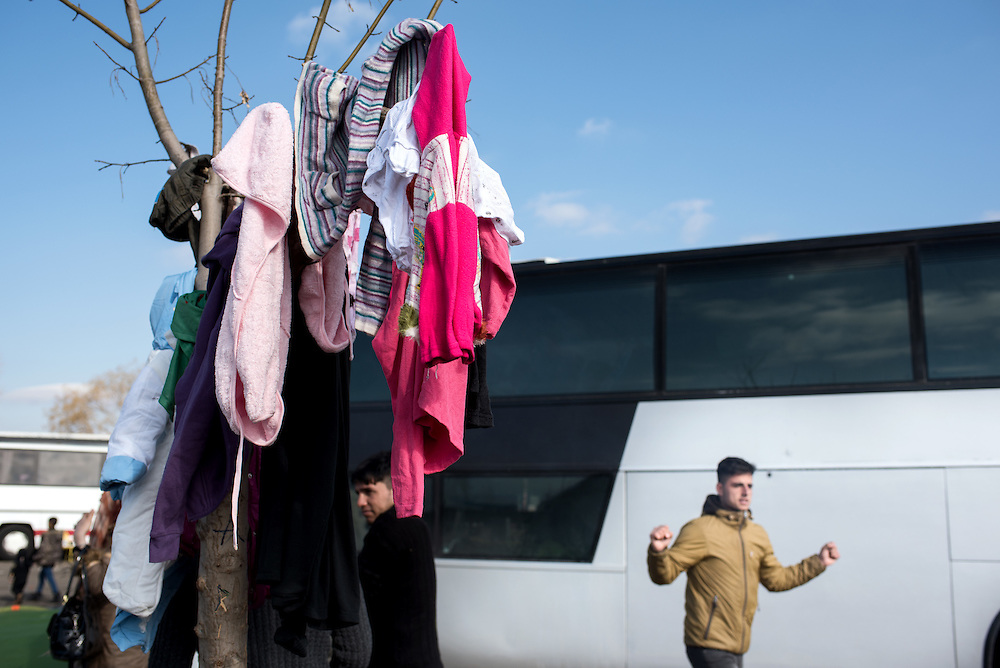 Refugees and migrants have to stay for a minimum 3 days in the busses that brought them from Athens at the petrol station near Idomeni. In the last few months the fields near this petrol station have become a transit camp for thousands of refugees and migrants waiting to cross to Greek Macedonian border.