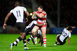 Gloucester Inside Centre (#12) Tim Molenaar is tackled by Fiji replacement (#21) Nikola Matawalu during the second half of the match - Photo mandatory by-line: Rogan Thomson/JMP - Tel: Mobile: 07966 386802 13/11/2012 - SPORT - RUGBY - Kingsholm Stadium - Gloucester. Gloucester Rugby v Fiji - International Friendly