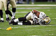 ST. LOUIS - SEPTEMBER 23:  Defensive tackle Damione Lewis #92 of the St. Louis Rams was thrown out of the game for unsportsmanlike conduct after a play in which he blocked and hit offensive guard Kendyl Jacox #64 (lying on the ground in pain) of the New Orleans Saints at the Edward Jones Dome on September 23, 2005 in St. Louis, Missouri. The Rams defeated the Saints 28-17. ©Paul Anthony Spinelli *** Local Caption *** Damione Lewis;Kendyl Jacox