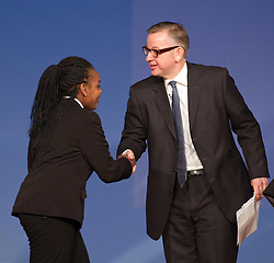 © Licensed to London News Pictures. 09/10/2012. Birmingham , UK . Student Anita Alliu , head girl of Perry Beeches Academy , shakes hands with Michael Gove . Michael Gove, the Secretary of State for Education, delivers his speech to the conference . Day 3 of the Conservative Party Conference at the International Convention Centre in Birmingham . Photo credit : Joel Goodman/LNP