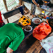 A local forest ranger prepares lunch in the jungle near Chiang Dao, Thailand. As Andrew Whiteford prepares to try a local delicacy.