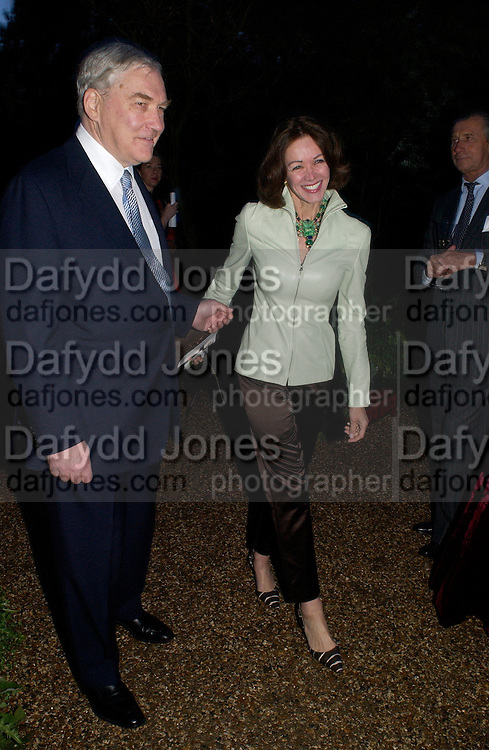 Conrad Black and Barbara Amiel, Cartier party, Chelsea Physic Garden. 19 May 2003. © Copyright Photograph by Dafydd Jones 66 Stockwell Park Rd. London SW9 0DA Tel 020 7733 0108 www.dafjones.com