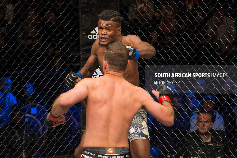 JOHANNESBURG, SOUTH AFRICA - MAY 13: Alain Ilunga punches Barend Nienaber during EFC 59 Fight Night at Carnival City on May 13, 2017 in Johannesburg, South Africa. (Photo by Anton Geyser/EFC Worldwide/Gallo Images)