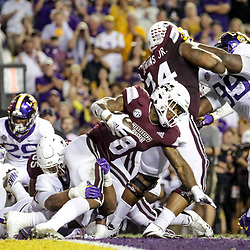Oct 20, 2018; Baton Rouge, LA, USA; Mississippi State Bulldogs running back Kylin Hill (8) is tackled by LSU Tigers defensive end Rashard Lawrence (90) during the first quarter at Tiger Stadium. Mandatory Credit: Derick E. Hingle-USA TODAY Sports