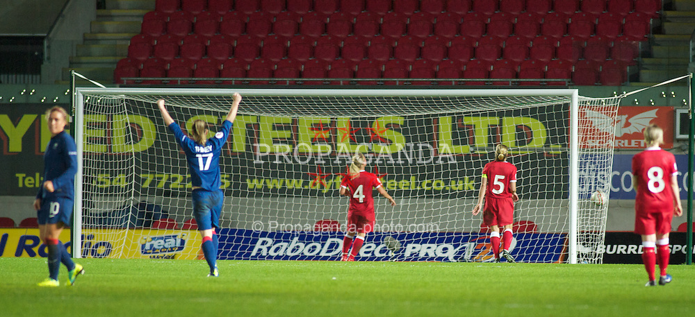 LLANELLI, WALES - Saturday, October 22, 2011: Wales' players look dejected as France celebrate making it 2-1during the UEFA Women's EURO 2013 Qualifying Group 4 at Parc Y Scarlets. (Pic by Gareth Davies/Propaganda)