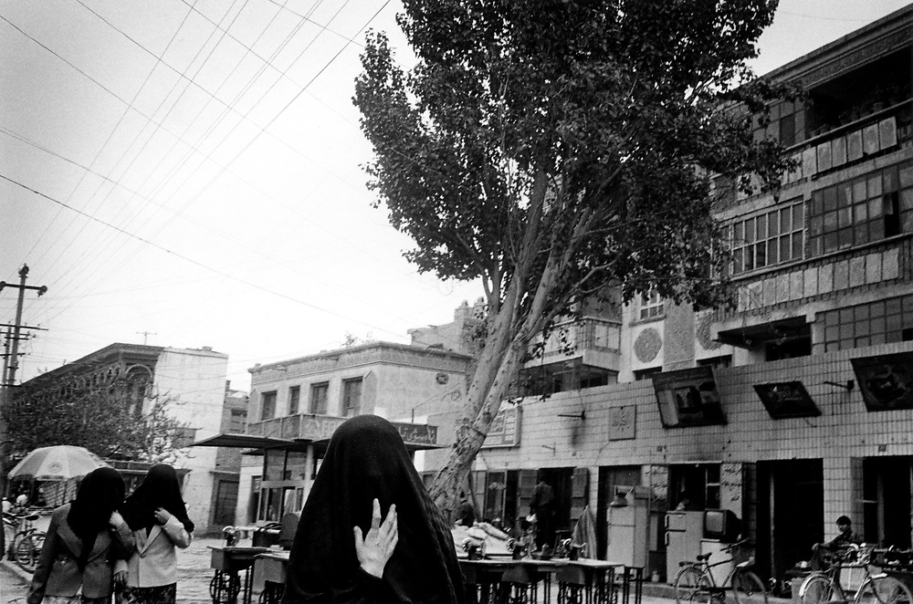 Xinjiiang Uygur Autonomous region. Kashgar. Uygur women walking the streets their faces covered when in public with a dark brown cloth.2000.