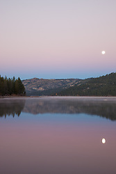 """Moon over Donner Lake Sunrise 1"" - This full moon was photographed setting over Donner Lake at sunrise in Truckee, California."