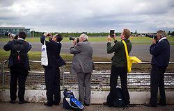 © London News Pictures. 09/07/2012. Farnborough, UK. Businessman and women film and photograph a Qatar Airlines Dreamliner Bowing 787 giving a flight demonstration on day one of the Farnborough International Airshow, in Farnborough, Hampshire, UK on July 9, 2012. FIA is a seven-day international trade fair for the aerospace industry which is held every two years at Farnborough Airport . Photo credit: Ben Cawthra/LNP.